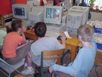 photo of 3 children in a computer lab