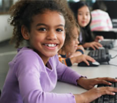 photo of smiling young girl at a computer